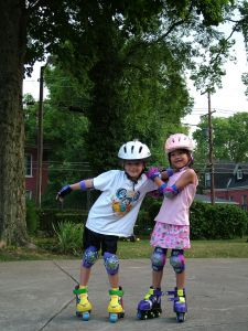 Friends on skates playing together